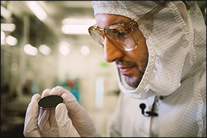 Technician Visually Inspecting a Gallium Wafer