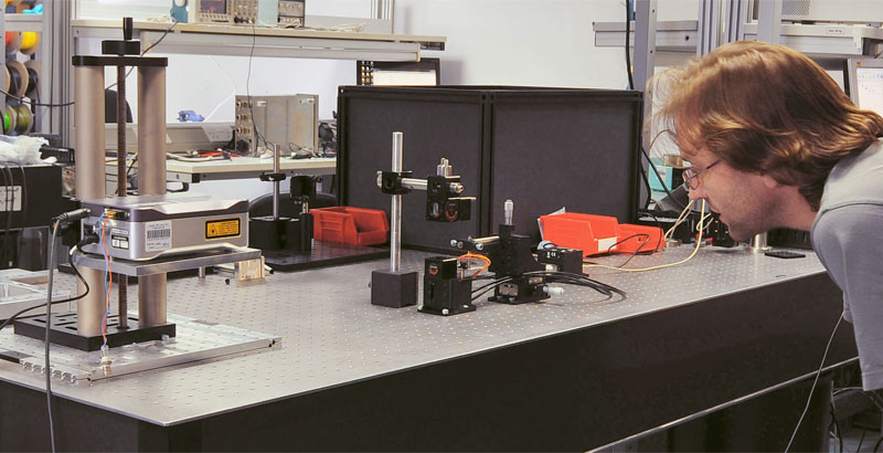 A mechanical engineer tests a prototype in the lab.